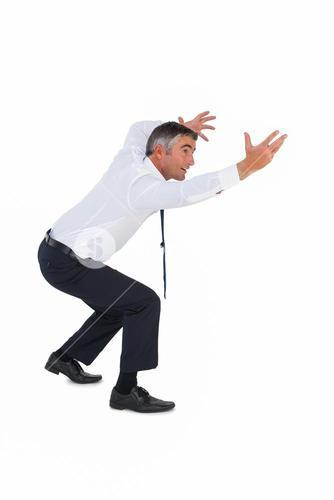 Businessman bending with arms up