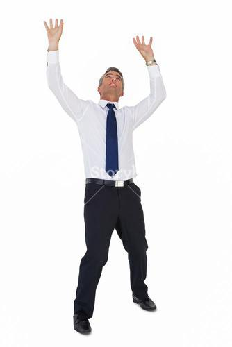 Businessman standing with arms up