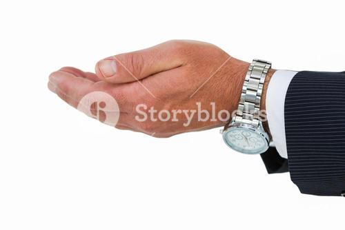 Businessman with wrist watch and hands out