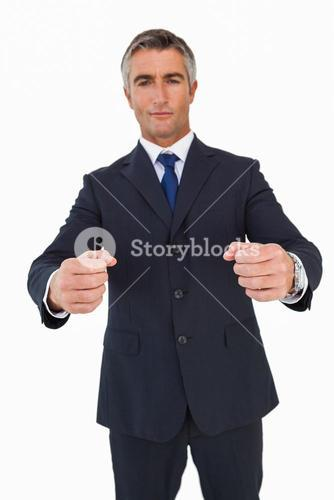 Portrait of a businessman clenching fists