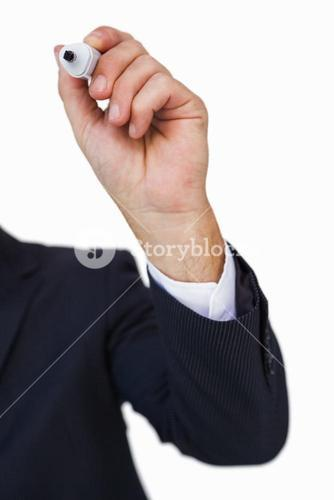 Hand of a businessman writing with marker