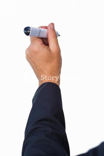 Businessman writing with marker
