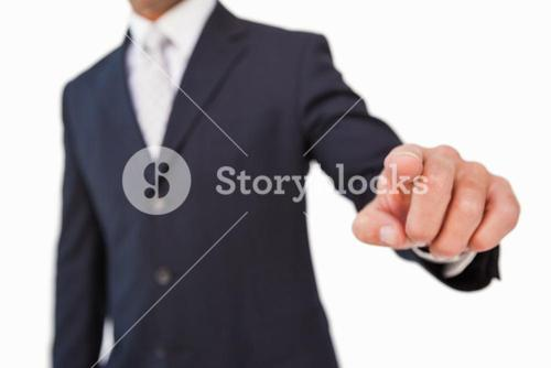 Businessman pointing with his finger