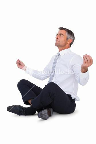 Relaxed businessman in lotus pose