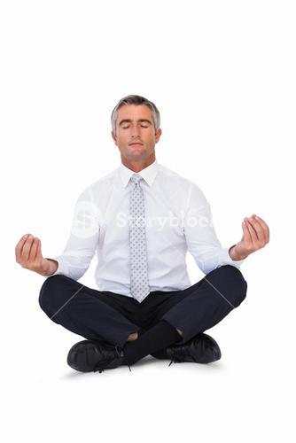 Zen businessman meditating in lotus pose