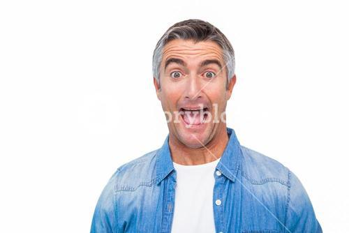 Portrait of a excited man in casual clothes