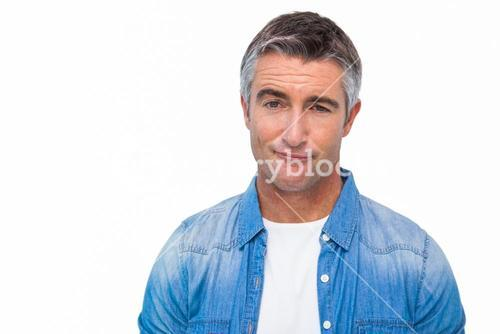 Portrait of a unsure man in casual clothes