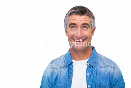 Joyful man in casual clothes looking up