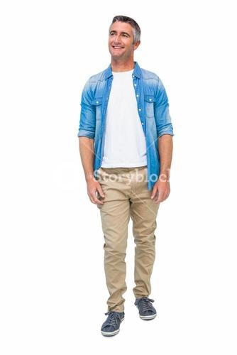 Smiling man in casual clothes posing