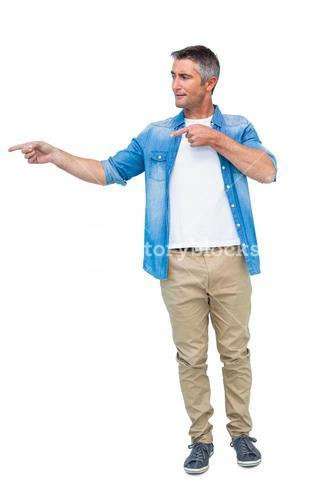 Smiling man in casual clothes pointing