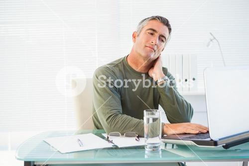 Concentrated man working with laptop