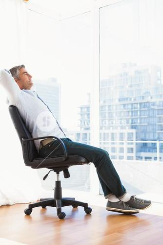 Man sitting on his office chair resting