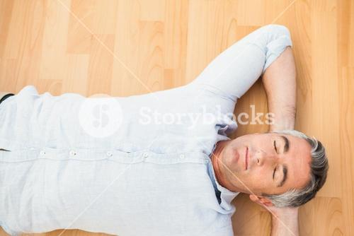 Man lying and relaxing on the floor