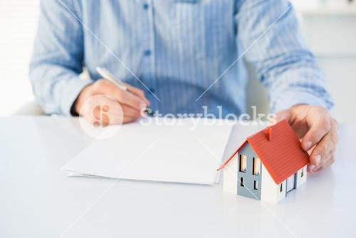 Man drawing the model house