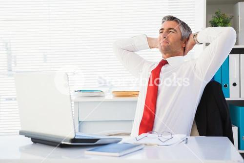 Relaxed businessman sitting and relaxing
