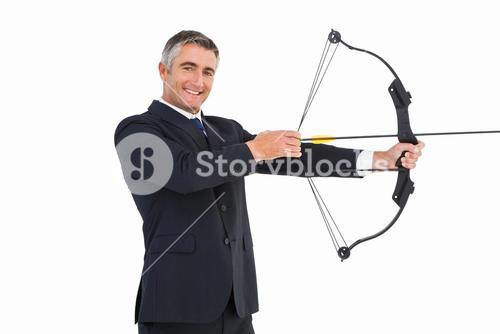 Smiling businessman stretching a bow