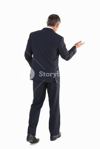 Businessman walking and doing gesture