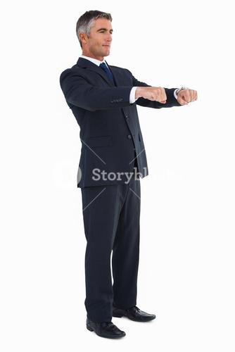 Businessman posing with open arms