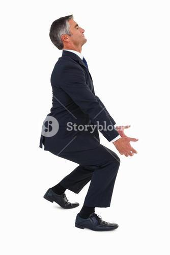 Businessman in suit carrying something