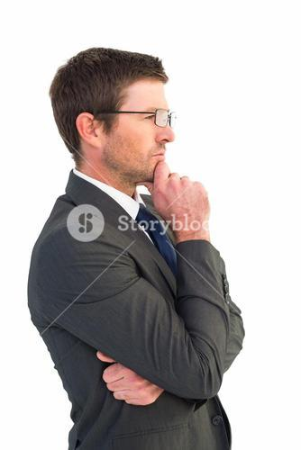 Frowning businessman thinking