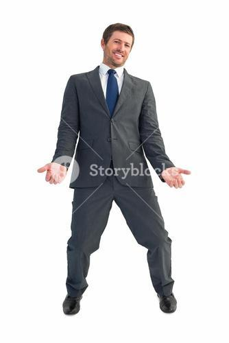 Businessman smiling with hands out