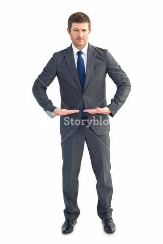 Businessman standing with hands out