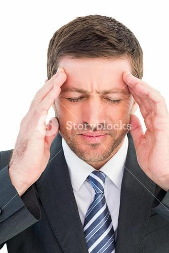 Businessman getting a headache