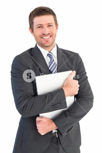 Businessman holding his laptop tightly