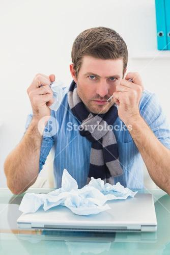 Stressed businessman looking at camera