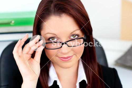 Charming businesswoman holding her glasses