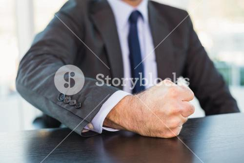 Angry businessman thump the table