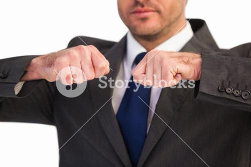 Mid section of a businessman with clenched fist