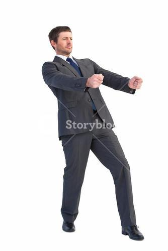 Handsome businessman pulling with hands