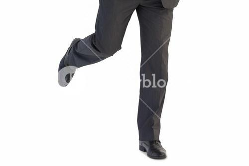 Handsome businessman in suit stepping