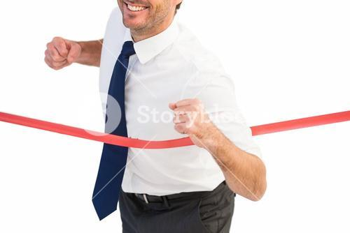 Businessman smiling and crossing the line