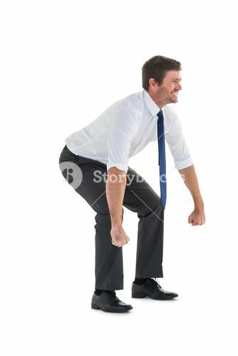 Strong businessman lifting up something