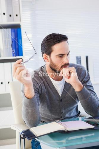 Young businessman organizing his schedule at his desk