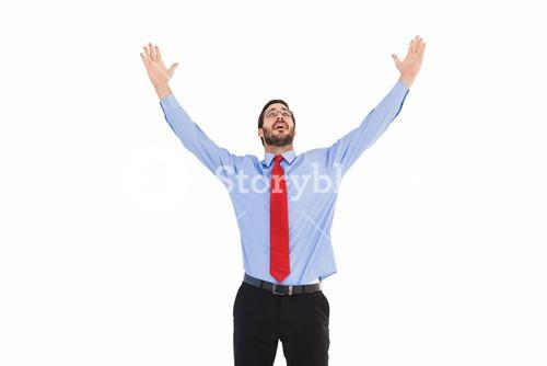 Happy cheering businessman raising his arms