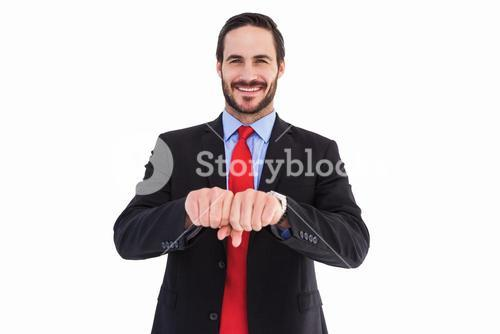 Smiling businessman with clenched fist in front of him