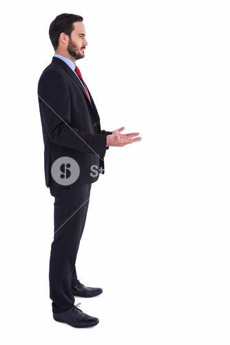 Frowning businessman presenting with hands