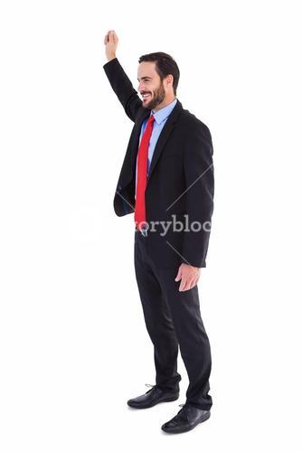 Smiling businessman standing with hand raised