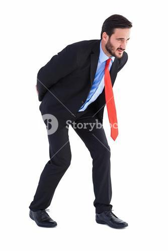 Businessman in suit carrying something heavy