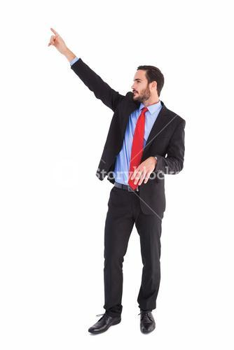 Handsome businessman pointing at something