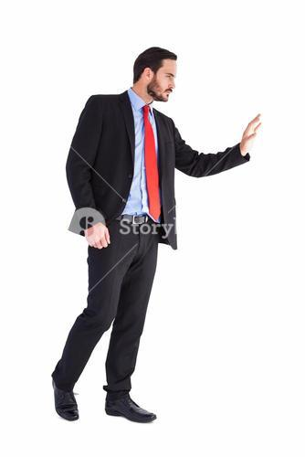 Businessman walking and presenting with hands