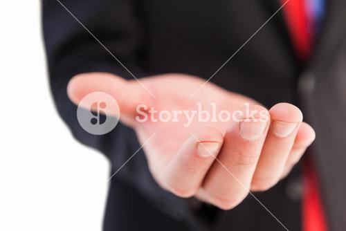 Businessman presenting with his hand