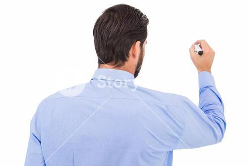Businessman in suit writing with marker