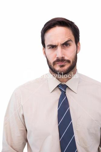 Portrait of a doubtful young businessman