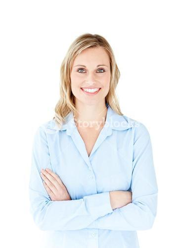 Selfassured businesswoman with folded arms smiling at the camera