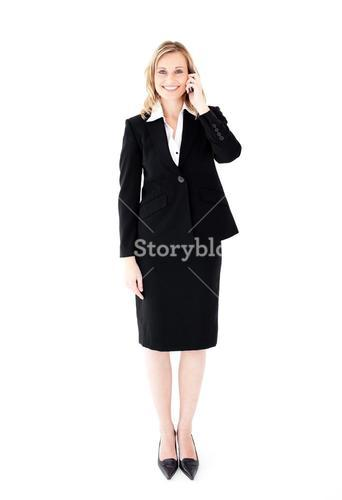 Pretty young businesswoman talking on phone
