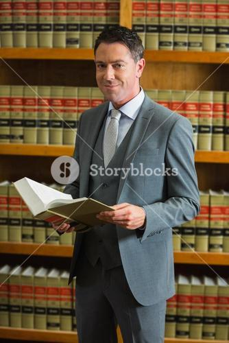 Lawyer holding book in the law library